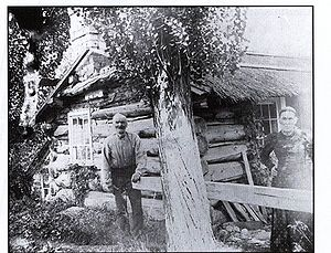 Joseph & Helen in front of cabin.1.jpg